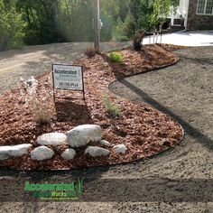 "Aluminum edging (widely available in black or silver/natural) is a brilliant alternative to concrete curb or paver edging in a landscaping bed.  The aluminum pieces, available in both 8'-0"" and 16'-0"" lengths, are simply assembled and create sweeping natural curves with ease."