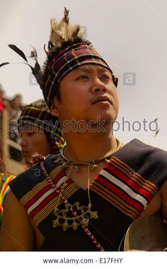 Portrait of Mizo tribe people at the Chapchar Kut festival wearing traditional costume for the bamboo dance. Mizoram North East India