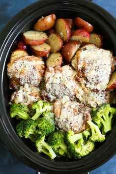 Slow Cooker Creamy Garlic Chicken and Veggies - A one pot crockpot meal! Tender chicken, potatoes and broccoli! Served with the creamiest garlic sauce ever!