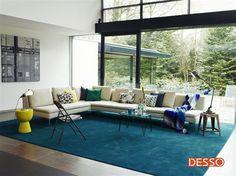 Desso Asteranne tapijt. De basis is neutraal maar het wooneiland van Parade tapijt geeft een huiselijk gevoel.