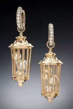 Who says a caged bird can't sing? Created by Christopher Duquet Fine Jewelry Design; Chicago; Materials: White Gold, Yellow Gold, Diamonds, Pearls