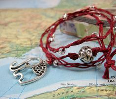 Santosha Collection Yoga Wrap Bracelet with Silver Elephant Charm on Red Waxed Linen on Etsy, $36.00