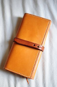 Hand Stitched Light Brown Leather Long Wallet. $125,00, via Etsy.