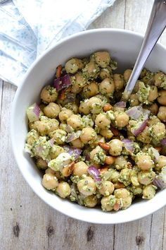 A simple recipe for Chickpea Pesto Salad tossed with basil pesto, crumbled feta and red onions. Perfect for on the go or as a tasty side dish.