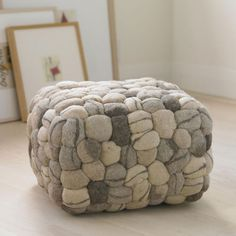 Clusters of natural felted wool are artfully woven with striations transforming into a faux riverstone pouf. Our pouf is phenomenally comfortable, firm yet …
