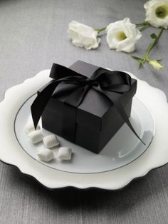Black Box Favors with Satin Ribbon -  via Brides®