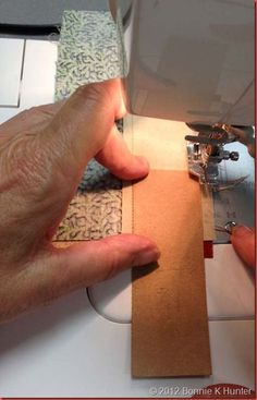 Another way to make sure you are sewing your strips straight.  Brought to us by Bonnie Hunter...what a great idea!