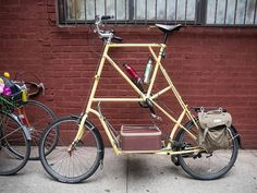 A tall bike with a place for your suitcase.
