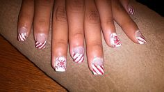 Did these nails for Christmas. Candy cane winter theme