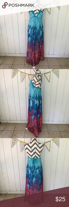 Satin and Chiffon Feather Maxi Dress This gorgeous, and breezy, maxi dress will keep you cool all summer long. It is perfect to wear to your next music festival. The multicolored feather print is beautiful. This chiffon dress is fully lined. It has a satin trim and satin straps that tie in the back. The straps can be worn crisscrossed or straight up-and-down. This dress is in very good used condition. The bottom hem shows a small bit of wear, but it is not noticeable enough to even…