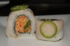Polly Roll: spicy krab and tempura jalapeno inside and topped with yellowtail and more jalapeno.