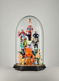plastic figurines in deed, but Lucas Mongiello make us see the vast aesthetic potential in his toys just the way they are. We love how Mongiello simply display the figurines under glass domes for us to witness a play … Read Diy Deco Rangement, Deco Disney, Toy Display, The Bell Jar, Bell Jars, Art Series, Displaying Collections, Glass Domes, Old Toys