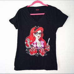 "Lowbrow Art Co. Alternative Ariel T-Shirt XL This super cute and pinky tee features artwork graphic of Ariel with tattoos, piercings, & other cute details. Juniors size XL, so might best fit a Large or Medium if wanting a less snug fit. About 36"" Bust. Worn a couple times, in excellent condition with no rips or tears. The slightest bit of fade from the wash. Lowbrow Art Co. Tops Tees - Short Sleeve"