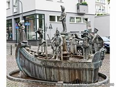 Das Narrenschiff/Ship of Fools, the Karl Berbuer Brunnen/Fountain, Karl-Berbuer-Platz, Köln/Cologne, Germany; dedicated to a composer and singer connected with Cologne's carnival, the ship is filled with carnival characters.