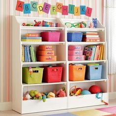 This is such an AWESOME bookshelf unit for a Childs Play Room!