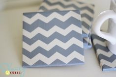 Acrylic paint on tiles.  Cut chevron pattern out of contact paper, stick onto tile, paint, pull off contact paper, let dry.  Add several coats of Mad Podge, and add felt feet on bottom.