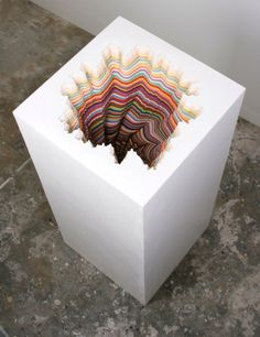 This paper sculpture is a good example of an emphasis on contrast. There is contrast in the colorful, kinetic, and organic interior versus the mechanic, static, and white cube extrerior