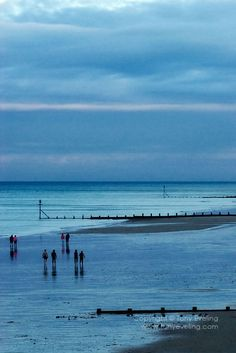People strolling along the beach at Overstrand, Norfolk,england,uk