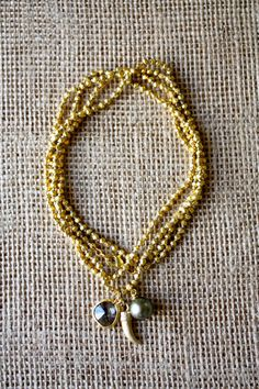 Handmade Gold Charm Necklace with Black Tahitian Pearl