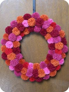 How have I lived my whole life without a pom pom wreath?