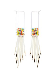 Huilo-Huilo Earrings by Kyyote: Made of cascading, artisan collected porcupine quills and woven seed beads. #Earrings #Porcupine #kyyote