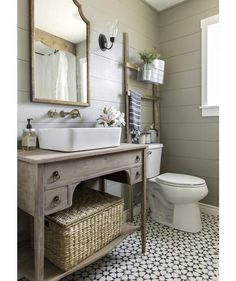 Wooden Ladder with Basket Above the Toilet