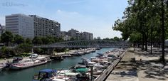 This shot taken looking down the south end of the Canal Saint-Martin you can see the Passerelle Mornay bridge which passes over the waters and over some of the many moored up boats below.  More information and details at www.eutouring.com/images_paris.html
