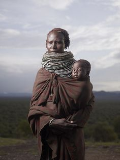 Africa | People. Karo mother and child.