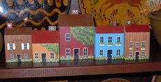 I found a bunch of this type of folk art signed by Bob Huffman...maybe from Missouri.