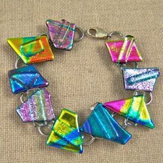 Rainbow Dichroic Link Bracelet by HaydenBrook on etsy.com. (Friendly Plastic: make shapes; layer bits of scrap f.p. or beads?)