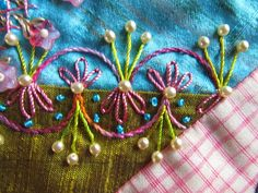 Pearls and candy colored crazy quilt stitches