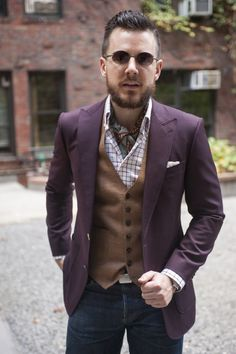 Choose a purple blazer and charcoal jeans if you're going for a neat, stylish look.  Shop this look for $330:  http://lookastic.com/men/looks/sunglasses-scarf-pocket-square-waistcoat-blazer-longsleeve-shirt-jeans/4378  — Dark Brown Sunglasses  — Grey Print Silk Scarf  — White Pocket Square  — Brown Waistcoat  — Purple Blazer  — White Plaid Longsleeve Shirt  — Charcoal Jeans