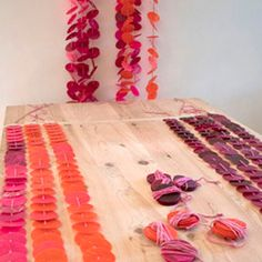 Learn how to make a colorful garland from wax + tissue paper!