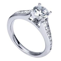 14k white gold 1.50cttw graduated channel set round diamond engagement ring with 1ct center. A twist on a timeless classic, this clean and classic channel set e