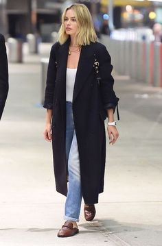 Le Fashion Blog Margot Robbie Casual Navy Blue Overcoat White T Shirt Blue Jeans Leather Mules Via Who What Wear