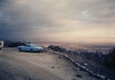 """""""In these L.A. pictures, I was drawn to certain light and colors, spaces, vernacular architecture, and automobiles that, to me, were characteristic of the place in a way that resonated with how I was feeling and the photographic agenda I had."""" – Adam Bartos  (All rights reserved. Images @ Adam Bartos and courtesy of …"""