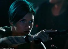 Action ready: Ruby is seen with her dyed green hair while pointing her fake pistol