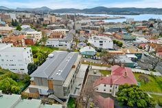 The Sandy Bay Road Apartments. This recently completed apartment complex is perfectly located in an established garden setting on Sandy Bay Road in Battery Point, TAS. Apartment Complexes, Sustainable Design, Apartments, Sustainability, Paris Skyline, Building, Garden, Travel, Garten