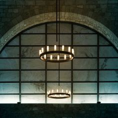 Chandelier (lighting): Suspension lamp. Structure in grey aluminium or black plated brass. Stainless steel Hanging cables. Sandblasted borosilicate glass diffusers. (designer: David Chipperfield   year: 2004) - More @ www.fontanaarte.com #fontanaarte #light #lamp