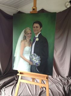Finished wedding portrait painting on easel by Gary Armer