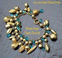 Loaded Charm Bracelet Vintage Filigree Teal Blue by AlchemyDivine https://www.etsy.com/listing/96151230/loaded-charm-bracelet-vintage-filigree?ref=shop_home_active_3
