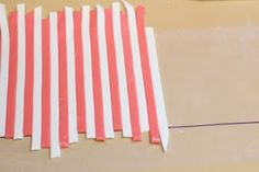 How to perfectly line up fondant stripes: use wax paper, grease them up lightly with Crisco so the stripes stick on it and begin laying out the pattern. Cut of excess or use template to cut out a design, then flip the wax paper over onto the cake and peel it off.