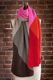 Interesting knitted scarf in multi-colours. Pattern for sale on ravelry for $6.00
