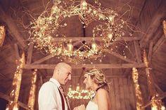 Homemade chandelier: hoolahoop, grape vine & lights!