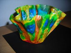 """This is what we will be doing in the 1st/2nd split class for Chihuli inspired art. These are coffee filters colored with water colors or even food coloring. Then place them over upside-down mason jars and spray with Spray starch. Let them dry and you have beautiful """"chihuli"""" like bowls."""