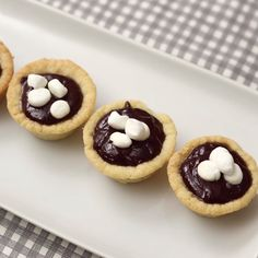 Stay cozy this Winter with these Hot Chocolate...Cookie Cups topped with Marshmallows. Cheers!