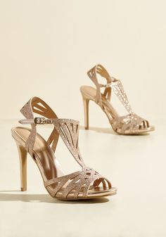 Play All the Spangles Heel | Mod Retro Vintage Heels | ModCloth.com  You make use of a supremely fashionable ensemble advantage each time you slip into these rose gold pumps! Harnessed with deco-inspired straps, and fastened with gold buckles atop shining stiletto heels, this gleaming pair offers the ultimate opportunity for you to flaunt a fab formal look.