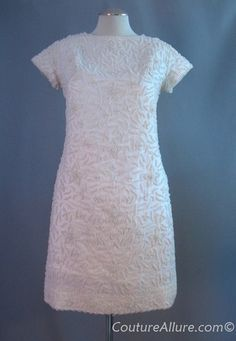 Vintage 60s Mod Beaded Wedding Dress Mini Medium bust 38    $165.00  In the 1960s, many women had dresses custom made on their trips to Hong Kong, where all the best beading was done at the time. This is one such dress, made in mini length for a Mod era bride.