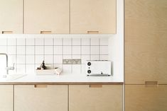 Birch plywood kitchen with Formica worktops with nice toaster