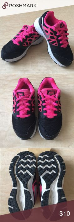 Girl's Nike Tennis Shoes Navy blue & pink Nike shoes. Gently used, plenty of life left in these sneakers. Nike Shoes Sneakers